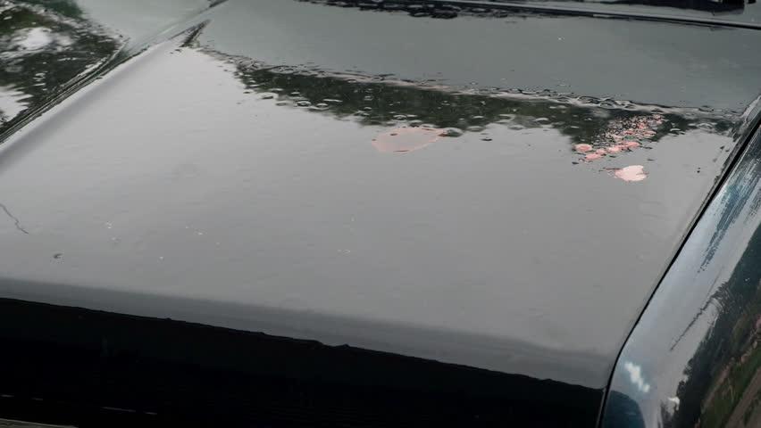 Rain falling on hood of blue rusty truck | Shutterstock HD Video #1015256620