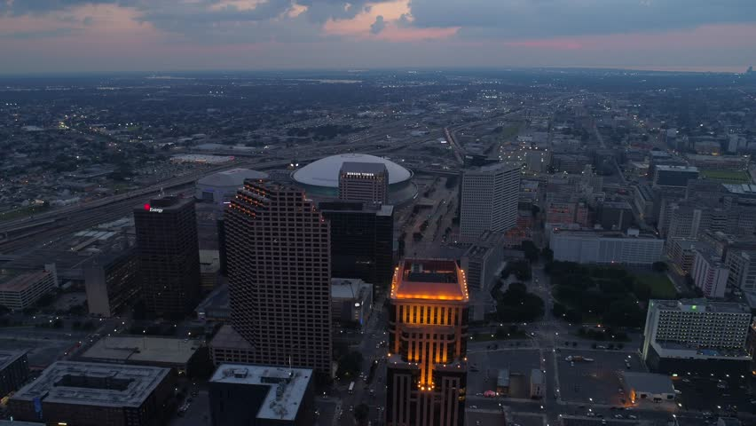 NEW ORLEANS, LOUISIANA, USA - AUGUST 1, 2018: Aerial night footage of New Orleans Louisiana towers downtown