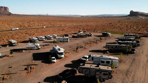 RV park (campground) near the Oljato–Monument Valley, Utah. Aerial view of parking, from above, drone shooting. Arizona - Utah border