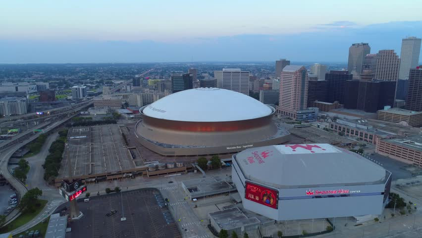 NEW ORLEANS, LOUISIANA, USA - AUGUST 1, 2018: Aerial Mercedes Benz Superdome flyover drone footage