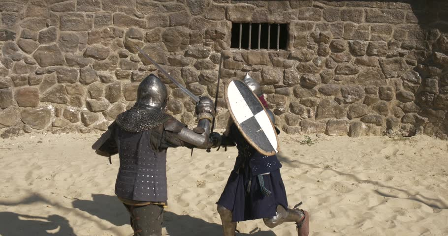 representation of the medieval duel of knights on swords