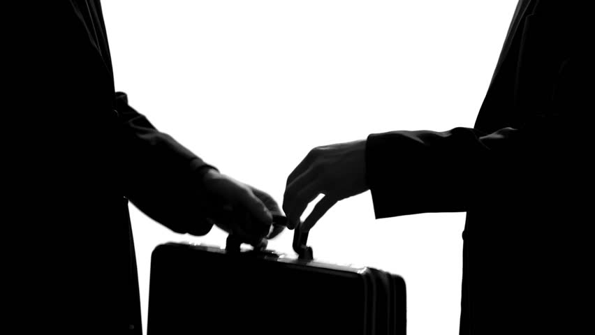 Businessman giving suitcase and shaking hands, underground economy, illegal deal