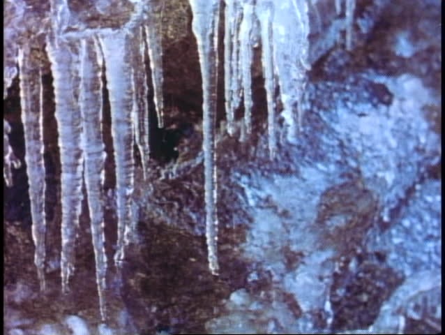 YOSEMITE NATIONAL PARK, CALIFORNIA, 1978, close up icicles dripping winter scene | Shutterstock HD Video #1015366240