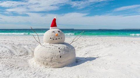 Time lapse video of Australian Christmas Sandman on a beautiful white sandy beach
