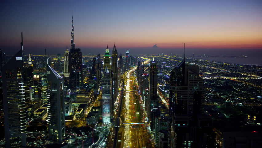 Aerial night illuminated city view Sheikh Zayed road commercial condominium district vehicle transport highway metro train UAE Middle East Dubai RED WEAPON | Shutterstock HD Video #1015444540