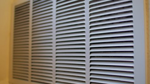 Slow move in on slighly dusty air conditioning vent