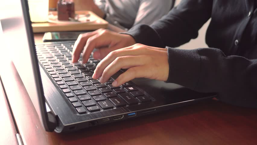 Woman hand using laptop to work study at working space in coffee cafe background. Business financial, trade stock maket and social network with freedom life concept. | Shutterstock HD Video #1015462720