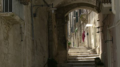 small lane with stairs in World Heritage site Matera, Italy,4k