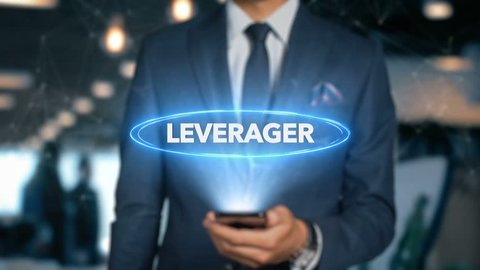 Businessman With Mobile Phone Opens Hologram HUD Interface and Touches Word - LEVERAGER