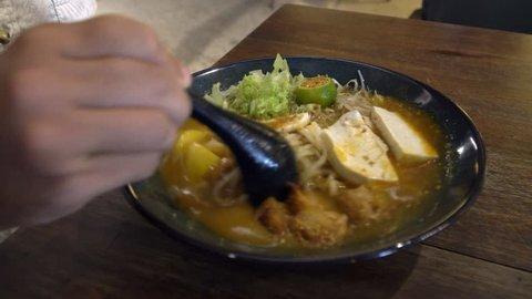 Eating Asian Noodle Soup Laksa. Top View