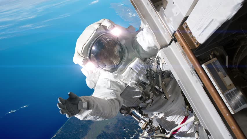 Astronaut working on a spaceship. Elements of image furnished by NASA. | Shutterstock HD Video #1015572280