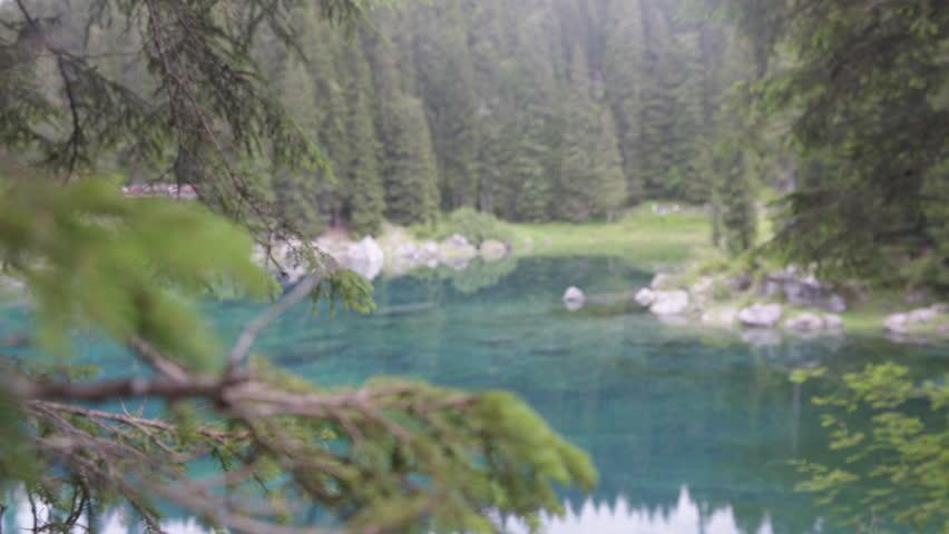 Beautiful landscape in a Calm waters on Lake Carezza in Dolomites, Italian Alps | Shutterstock HD Video #1015611760