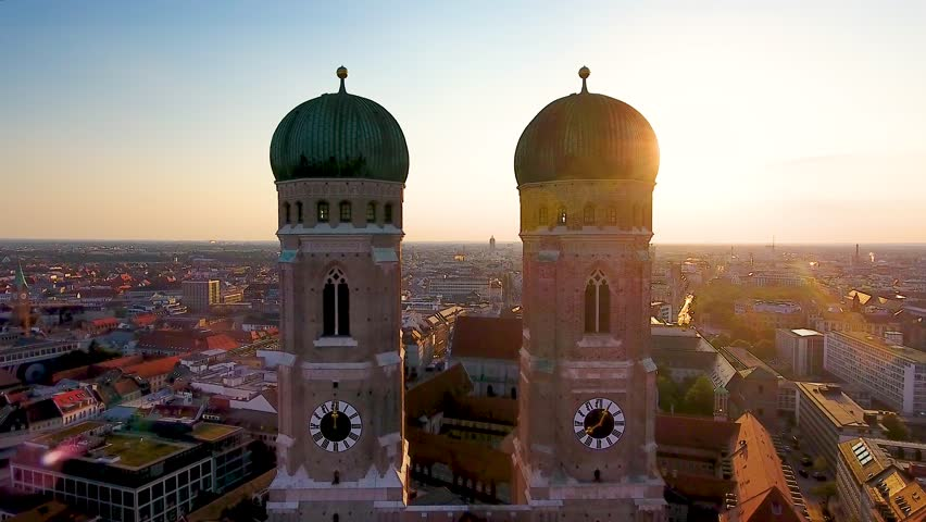 Aerial view of Munich City Germany at sunrise, Cathedral Church of Our Lady (Frauenkirche) in munich old town Marienplatz. Beautiful Munchen Skyline aerial view at morning. Munich skyline panoramic. | Shutterstock HD Video #1015647550