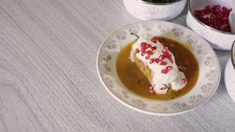 Chiles en nogada, traditional mexican dish from Puebla, Mexico. It consists of poblano chilis filled with picadillo topped with a walnut-based cream sauce, pomegranate and chopped parsley.