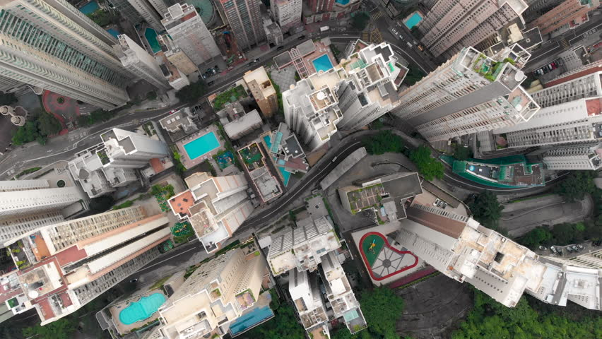 Aerial drone shot of congested building area of Hong Kong city and traffic | Shutterstock HD Video #1015702510