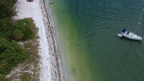 Sailboat anchored offshore of Lido Beach in Sarasota, Florida