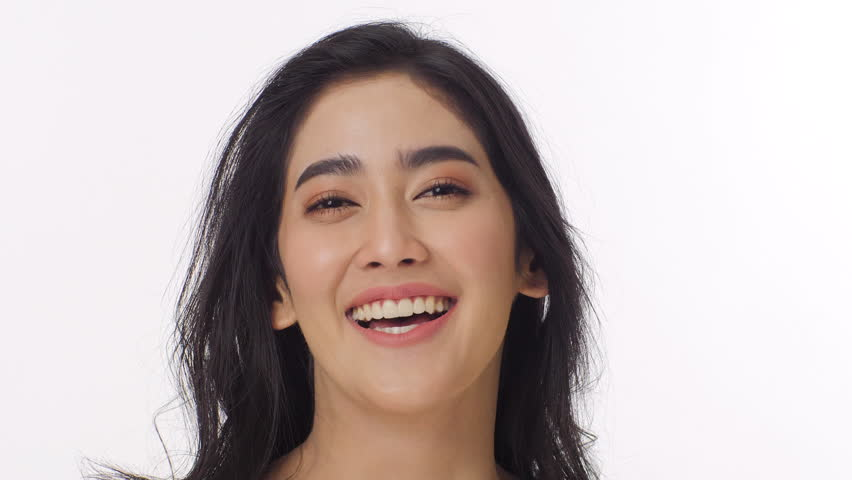 Attractive asian woman smiling and laughing at camera on white background. Beauty and fashion concept. | Shutterstock HD Video #1015780630