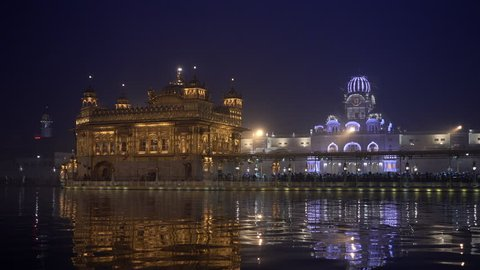 Video of Sikh pilgrims in the Golden Temple at dusk during celebration day in December in Amritsar, Punjab, India. Harmandir Sahib is the holiest pilgrim site for the Sikhs.