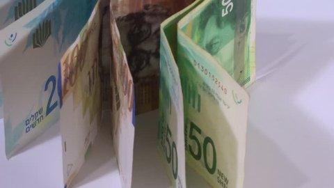 Rotating Israeli money. Shekels of Israel