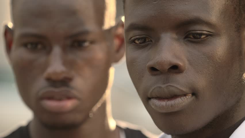 Immigration, suffering, Two sad African immigrants in the street | Shutterstock HD Video #1015859530