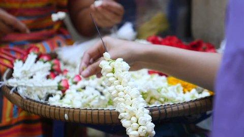 Hand of Asian Women Doing Flowers For Religious Worship
