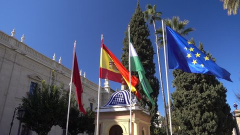 Collection Of National Flags The Sevilla City, Spanish, Andalusian And European Union Flags In Seville Spain