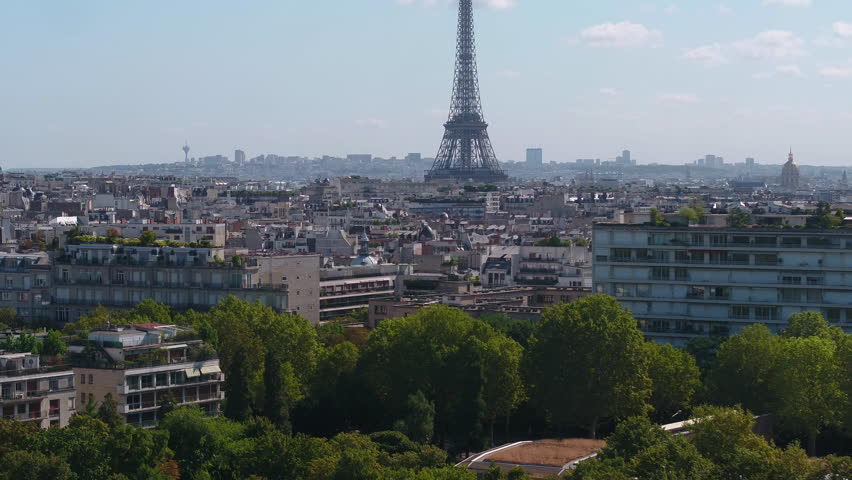 Aerial France Paris Eiffel Tower August 2018 Sunny Day 90mm Zoom 4K Inspire 2 Prores  Aerial video of the Eiffel Tower on a sunny day with a zoom lens in Paris France. | Shutterstock HD Video #1015903630