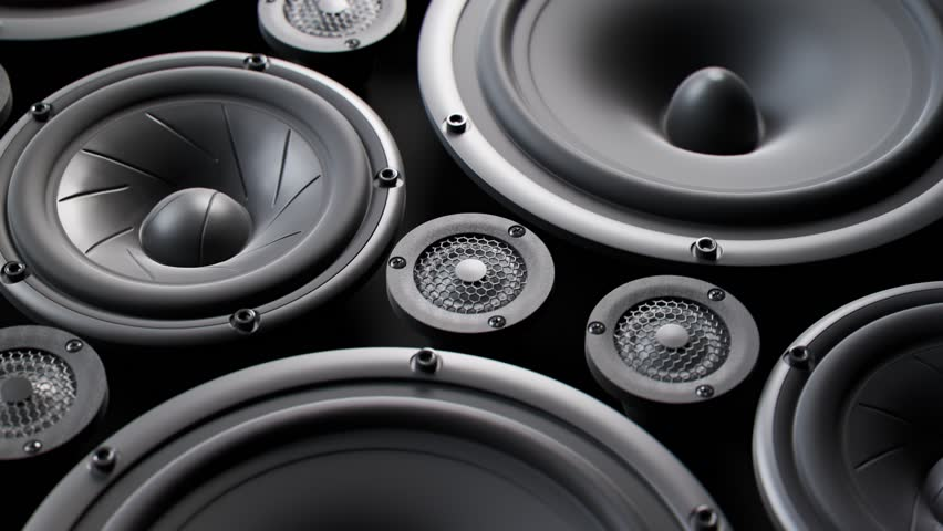 Vibrating speaker membranes stacked in an endless loop. Lit by soft, moody studio lights. Powerful, modern kind of midrange, subwoofer and twitter loudspeakers vibrate in even, pulsating frequencies.  | Shutterstock HD Video #1015905040