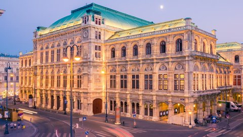 Vienna opera house at sunset. Time lapse. Camera moves from left to right. Change day to night.