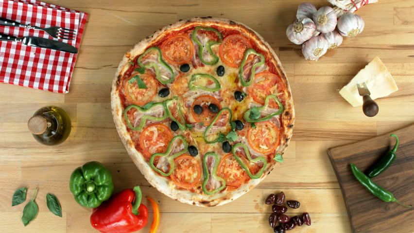 Served pizza being cut to slices. Top view, female hands.  | Shutterstock HD Video #10159130