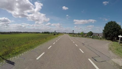 POV driving on polder dike near river Rhine in Holland between Amerongen and Wijk bij Duurstede backwards view