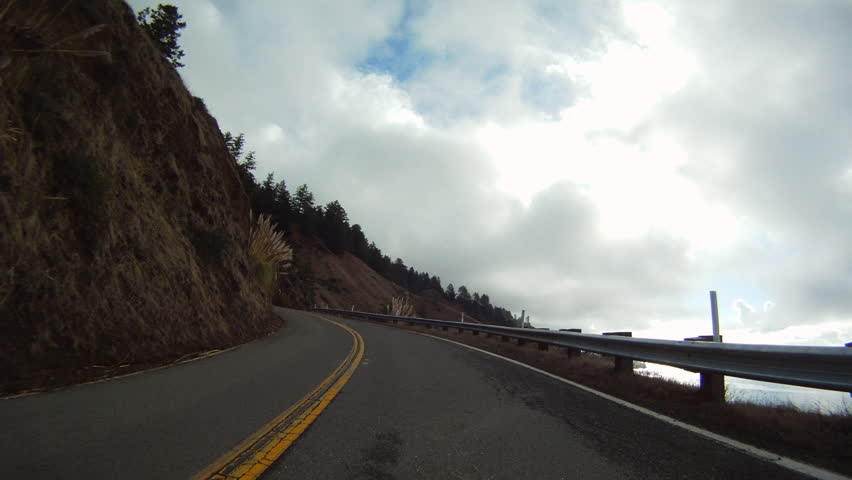 Time-Lapse: Cars Driving on a Road Along Cliff   Shutterstock HD Video #1015962220