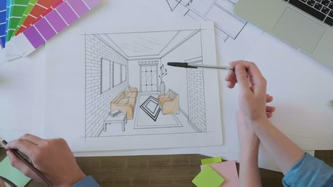Top view interior designers working on the interior sketch