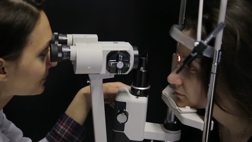 Close-up. The doctor performs a patient's vision study using the newest technology.4K | Shutterstock HD Video #1016062630