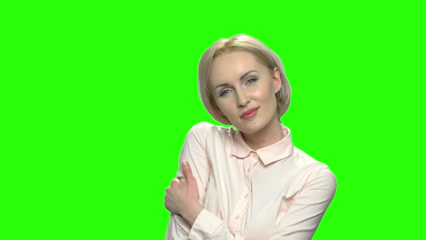 Portrait of mature sexy woman in formal shirt seducing. Green hromakey  background for keying.