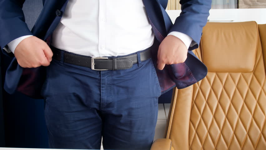 4k video of businessman standing at office and taking one coin from pants pocket | Shutterstock HD Video #1016086990