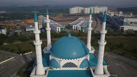 Aerial Cinematic Time lapse of a beautiful Sultan Iskandar mosque at daylight in Johor Bahru, Malaysia
