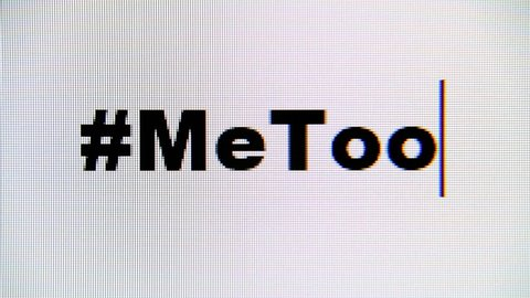 Typing the hashtag #MeToo on a computer monitor. Macro detail shot.