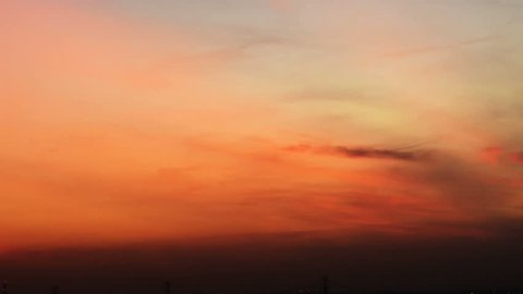 4K Time lapse sunrise and beautiful fluffy storm cloudy yellow gold sky smoothly flowing to fantastic mind. Rainny good morning and have a nice day concept. Relaxing on holiday after busy business