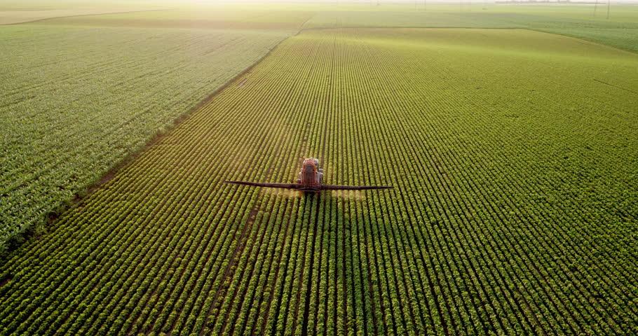 Aerial drone shot of a farmer spraying soybean fields #1016154850