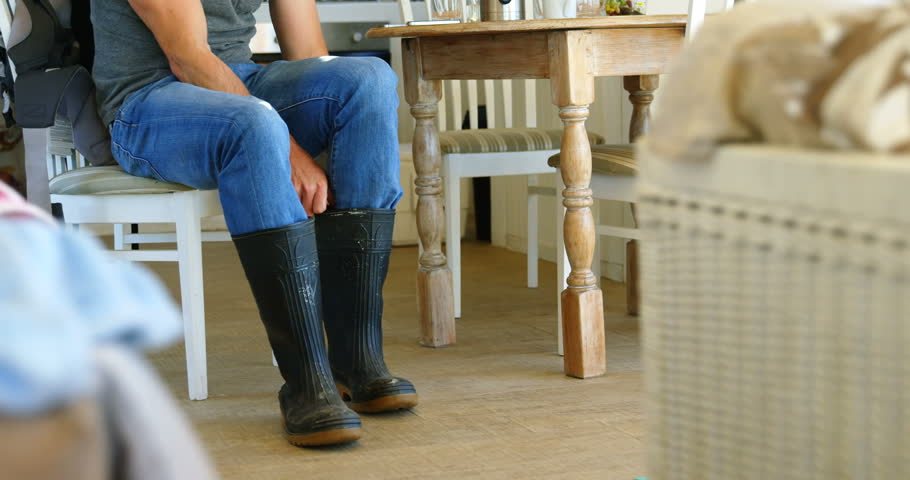 Low section of man wearing wellington boot at home 4k | Shutterstock HD Video #1016156650