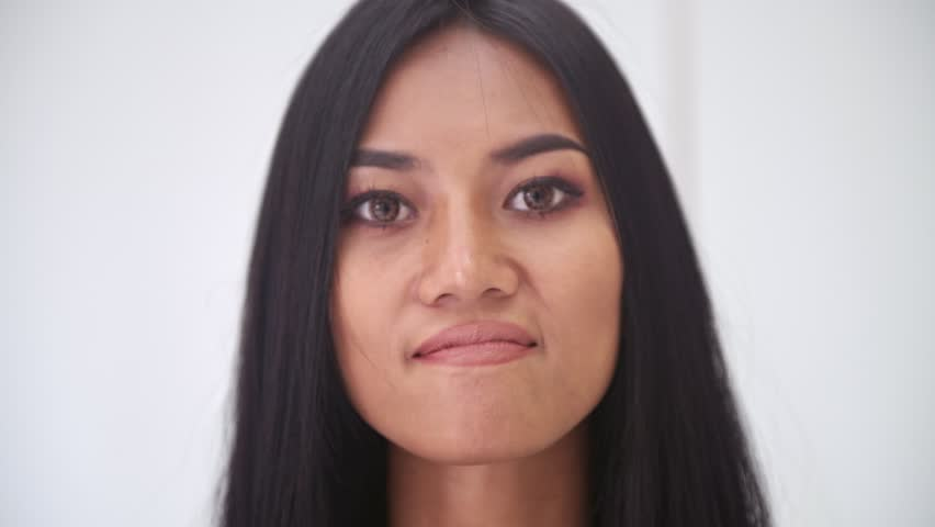 Woman portrait. Angry Asian woman portrait. | Shutterstock HD Video #1016211040