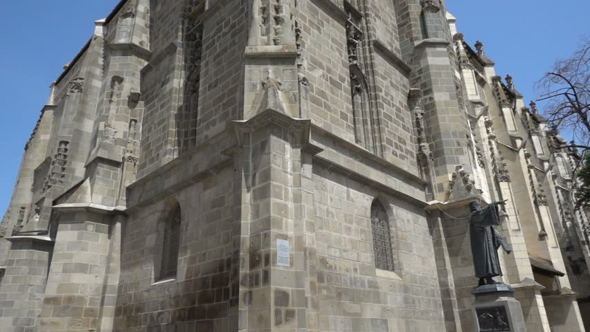 Footage of gothic architecture, The Black Church in Brasov, Romania, corner view tilt