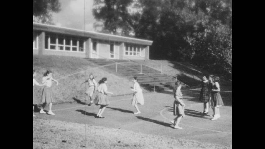 1950s: Kids play jump rope outside. Kids play baseball outside. Kids sit around a table, talk.