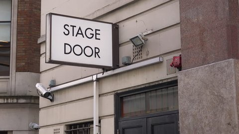CIRCA 2018 - A generic stage door leads actors and performers to the backstage of a local theater in London, England.