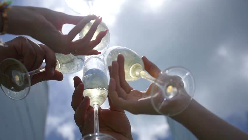Friends standing on a yacht, raise glasses with champagne, say a toast, celebrate. view from below on glasses. slow motion, HD, 1920x1080   Shutterstock HD Video #1016244970