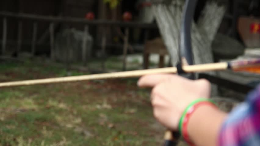 The girl shoots an arrow of arrows, concentration,   Shutterstock HD Video #1016277940