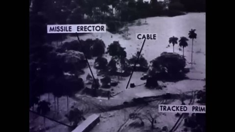 CIRCA 1960s - An animation shows Cuba and Secretary of Defense Robert McNamara speaks at a press conference.
