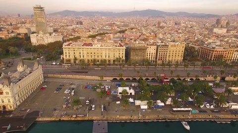 Wide angle aerial view flying horizontally over the harbor in Barcelona revealing the Christopher Columbus Monument