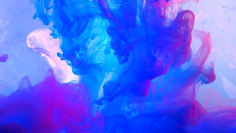 Neon violet and pink ink in water shooting with high speed camera. Mixed paints reacting, creating abstract cloud formations and metamorphosis on white. Art backgrounds.